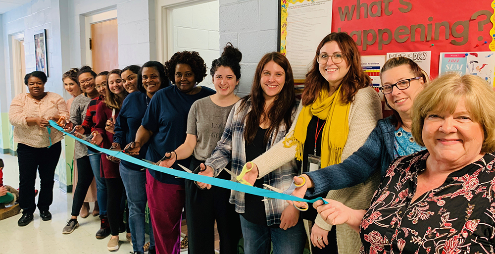 Our Early Childhood Educators, CEO Donna McConnico and Chief Program Officer Carolyn Boyd cut the ribbon on the new teacher work room.